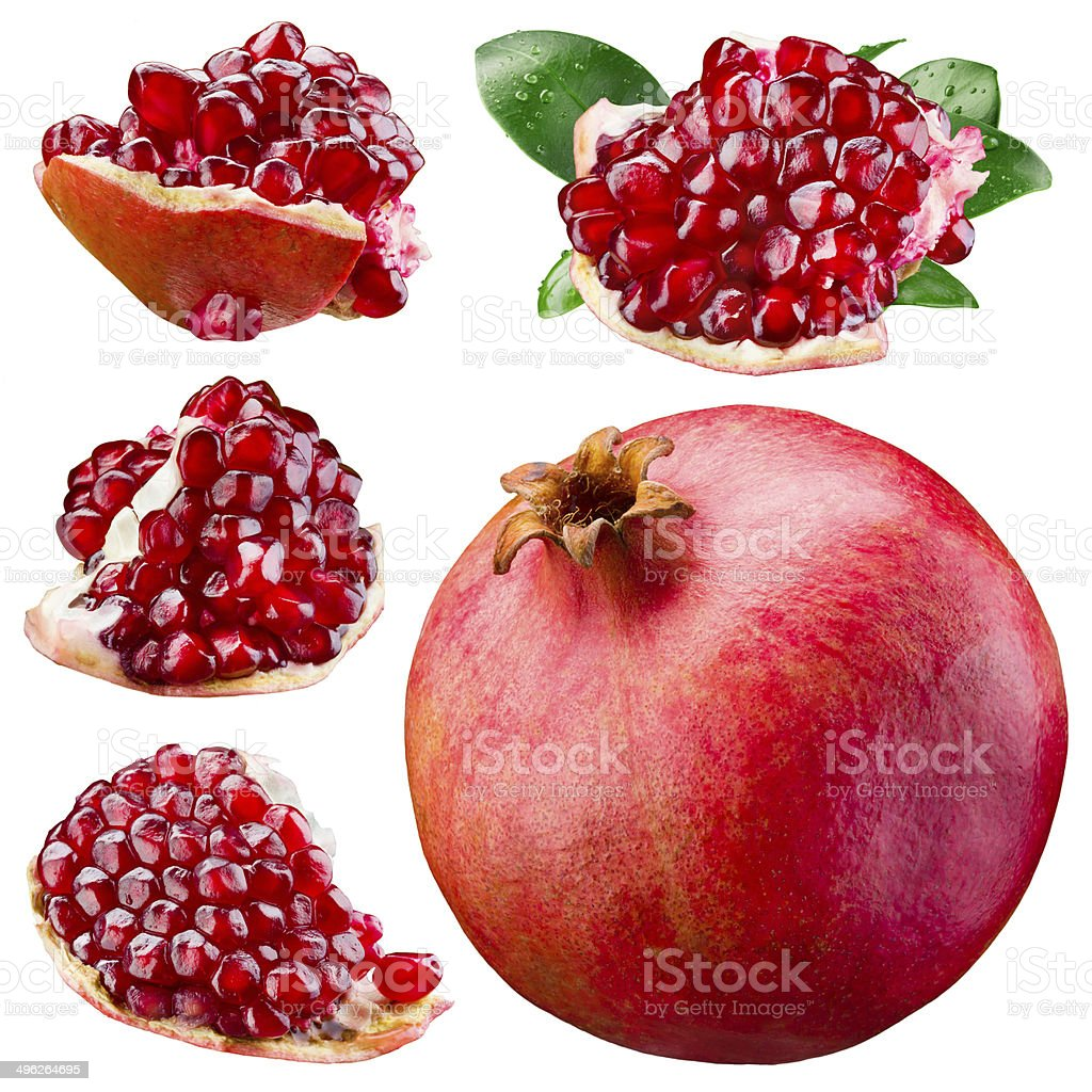 Ripe pomegranate, section and leaves isolated on a white. Collection stock photo