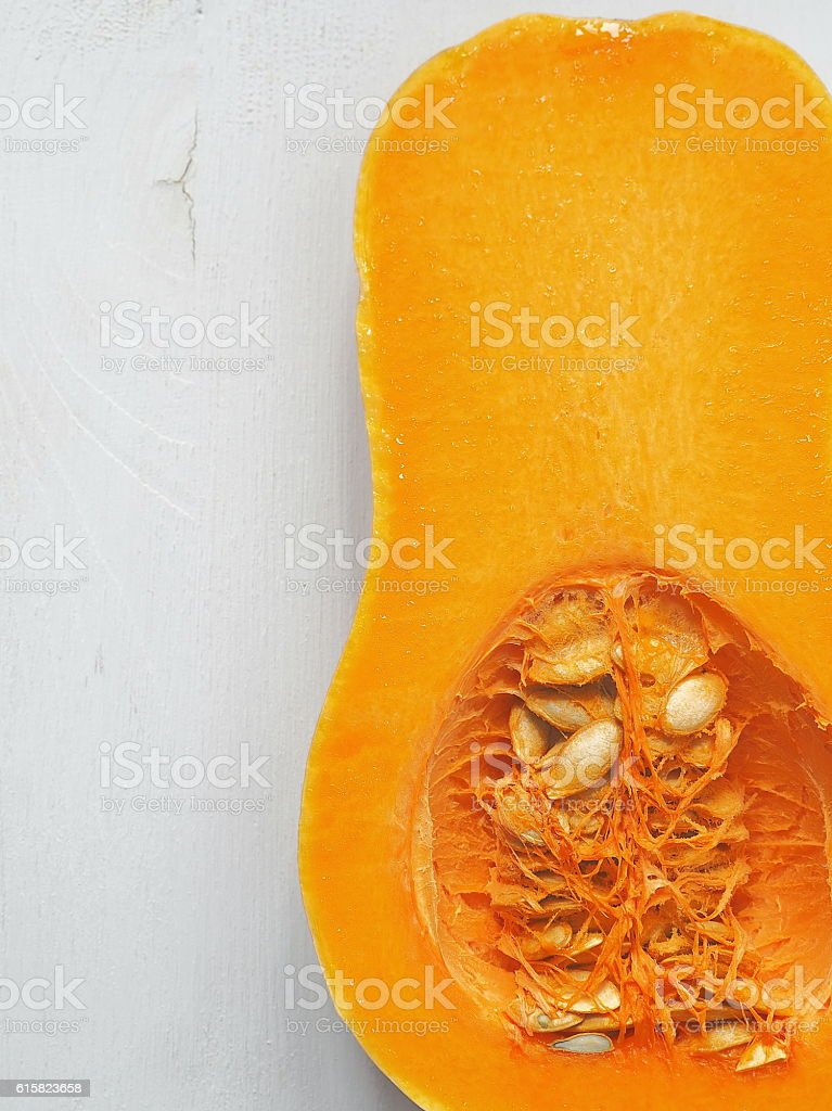 Ripe pumpkin. Butternut squash upon old wooden background. stock photo