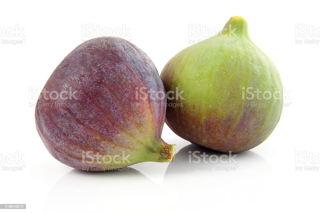 Ripe purple and green fig fruit isolated stock photo