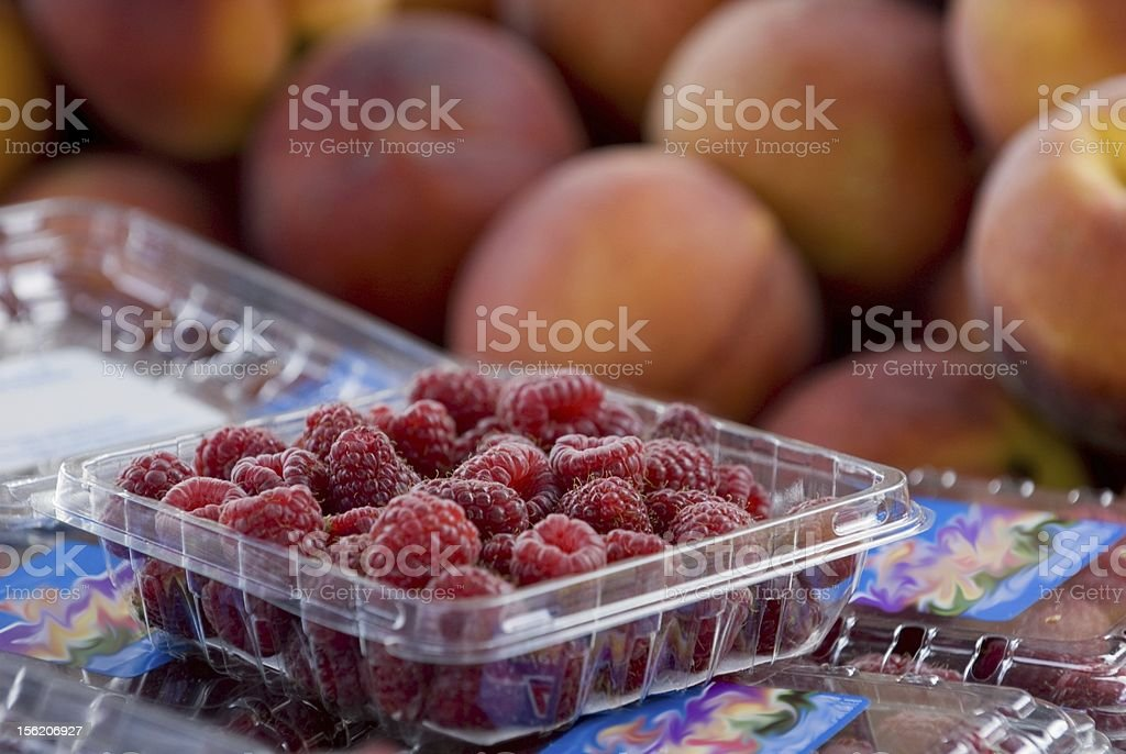 Ripe Raspberries and Peaches royalty-free stock photo