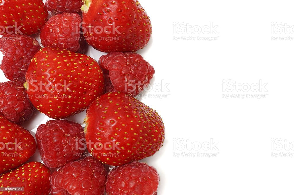 ripe raspberries and strawberries border isolated royalty-free stock photo