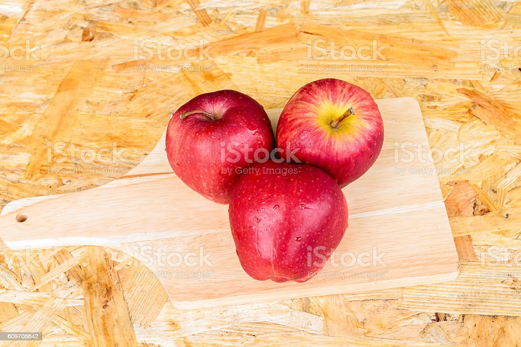 Ripe red apples on wooden background stock photo