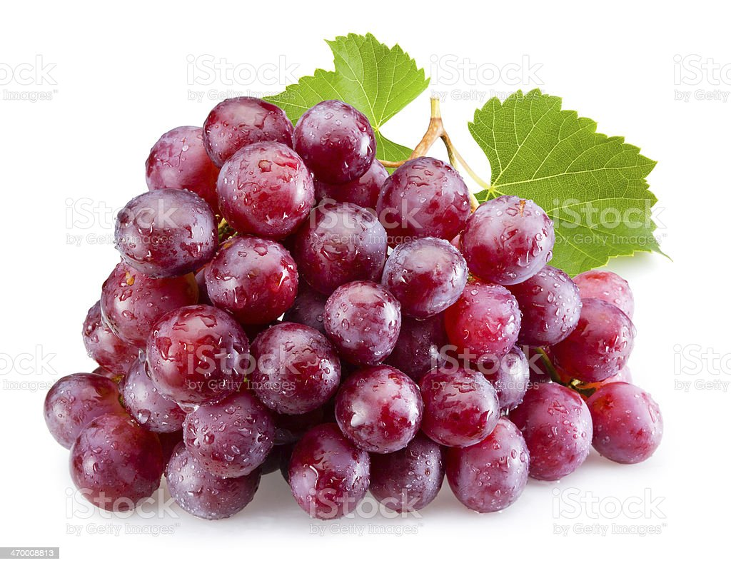 Ripe red grapes with leaves isolated stock photo