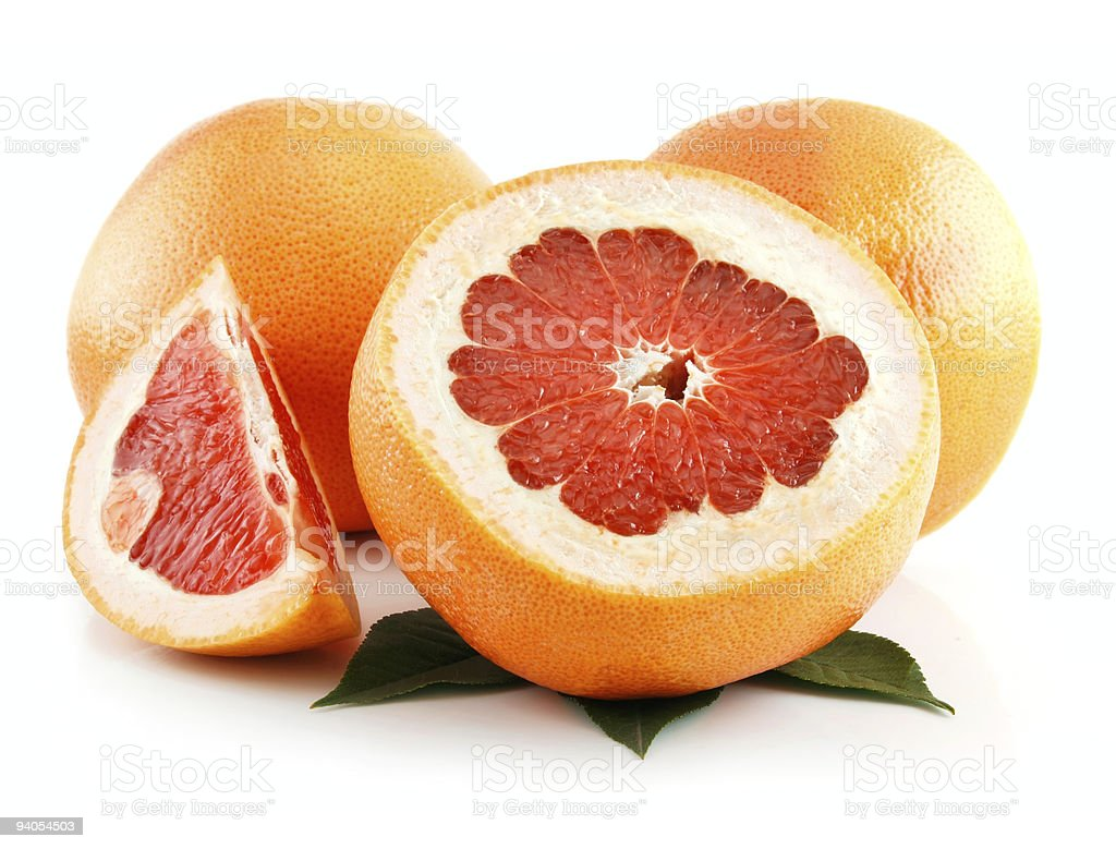 Ripe Sliced Grapefruit with Leaves Isolated on White stock photo