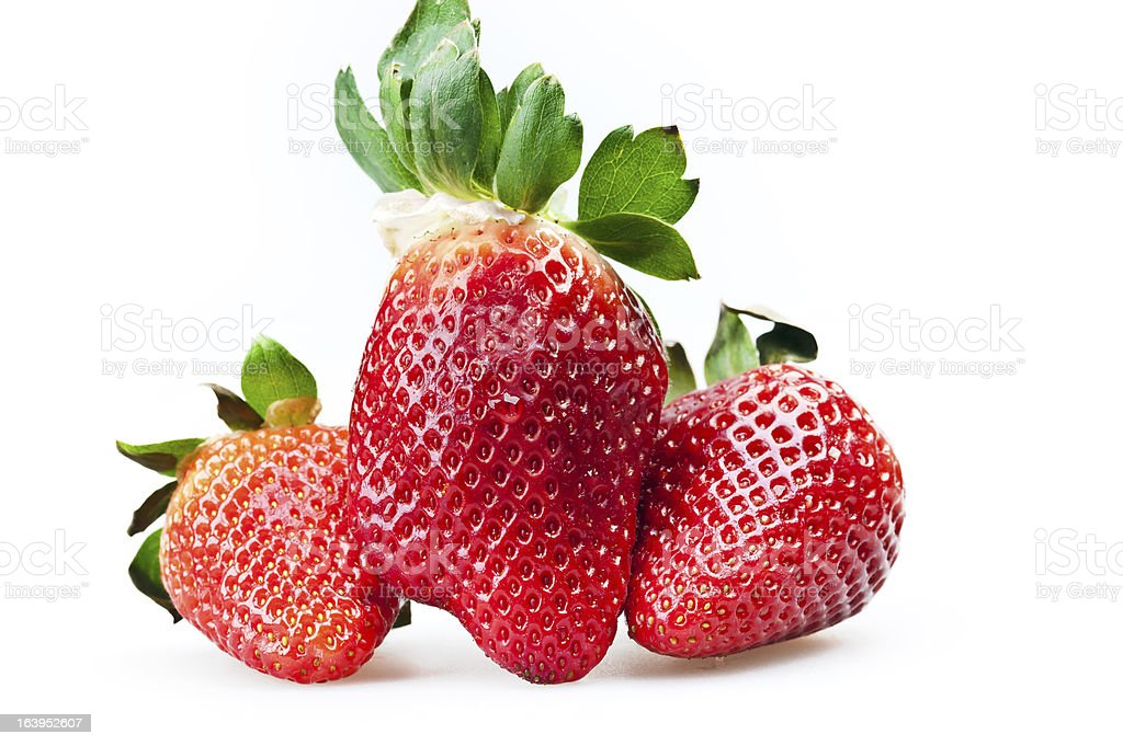 ripe strawberries isolated on white royalty-free stock photo
