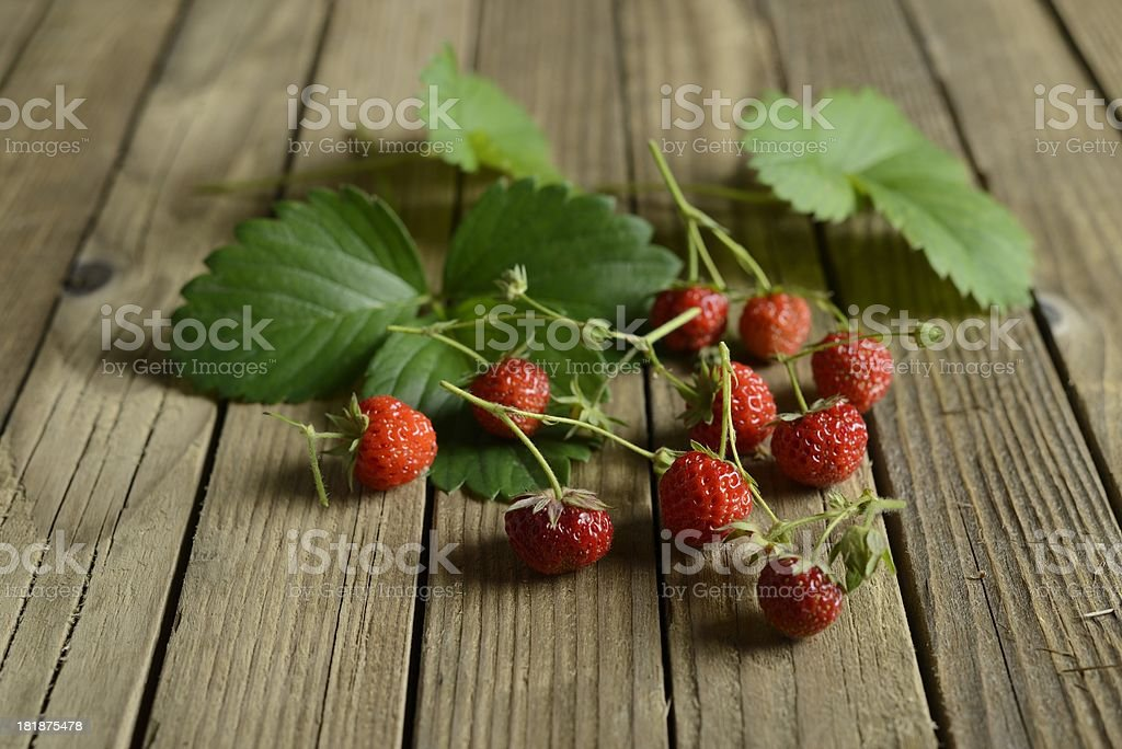 Ripe Strawberries on wooden table royalty-free stock photo