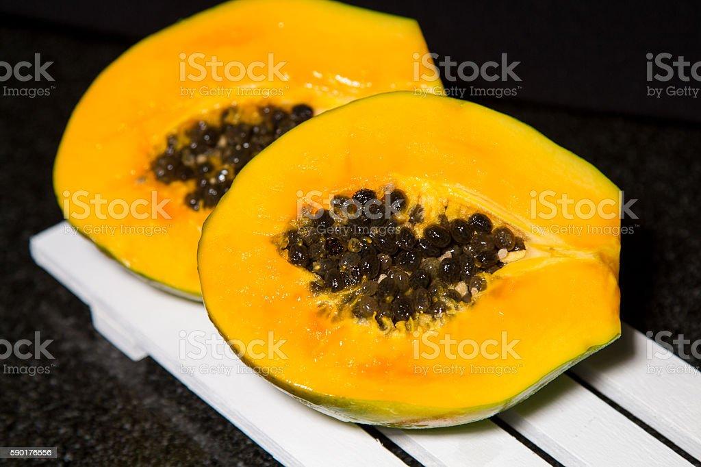 Ripe sweet papaya  black background stock photo