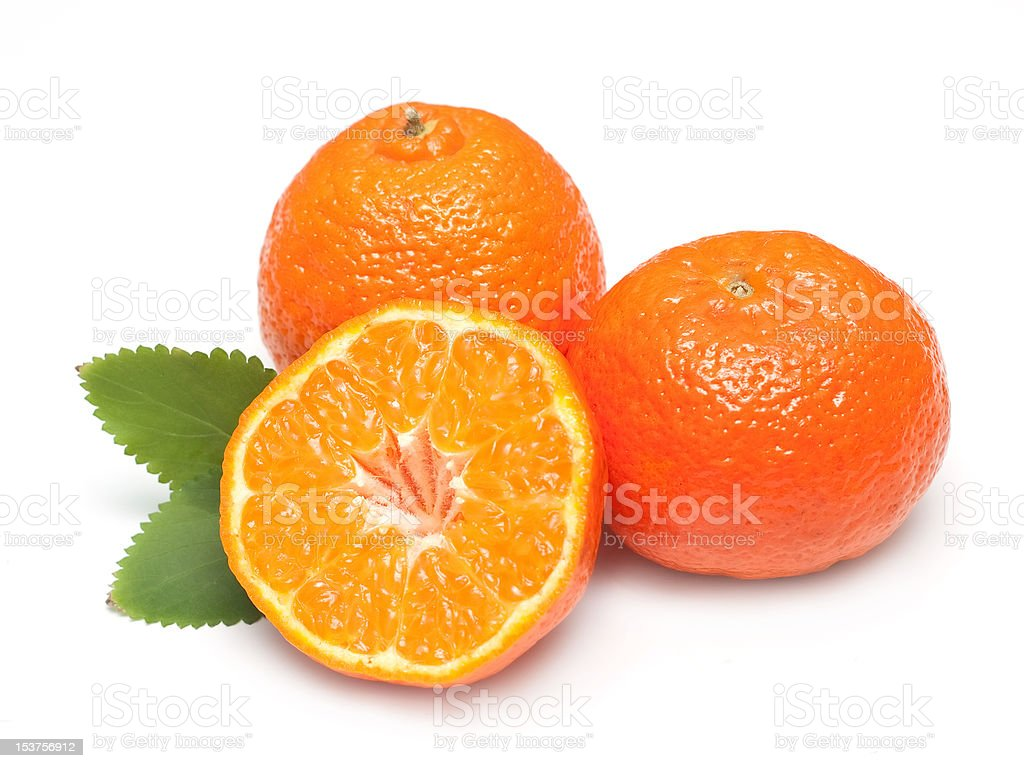 Ripe tangerines with leaves and slices royalty-free stock photo