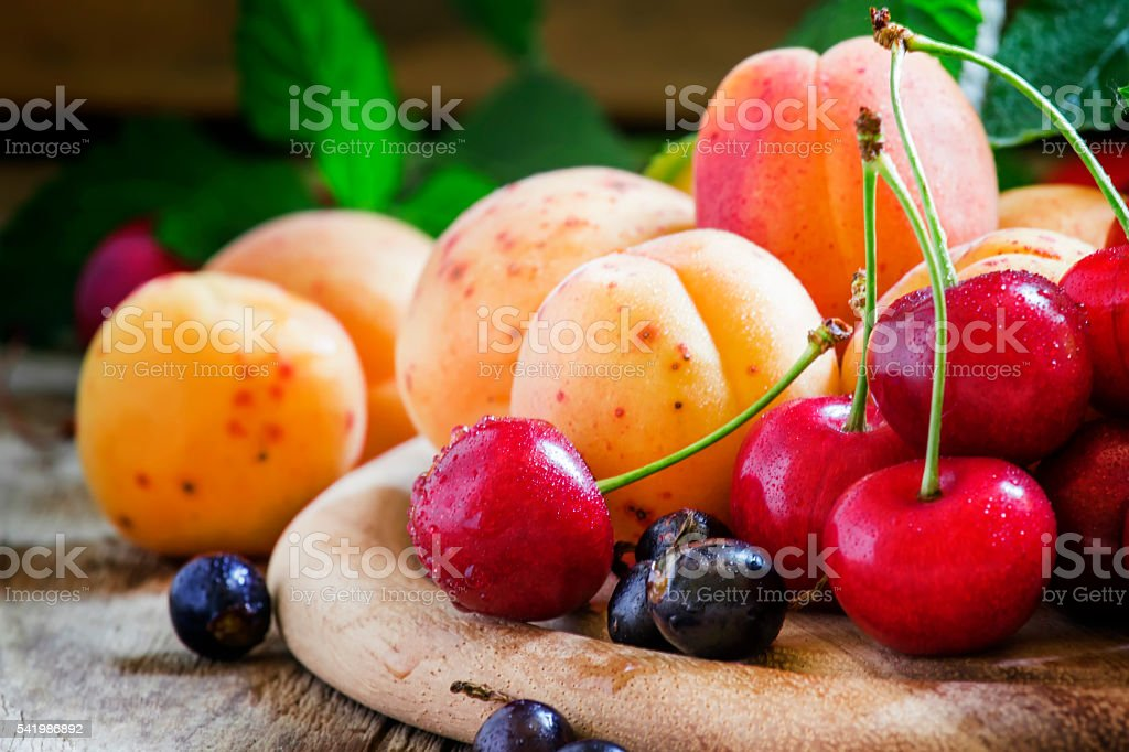 Ripe tasty summer fruits and berries stock photo