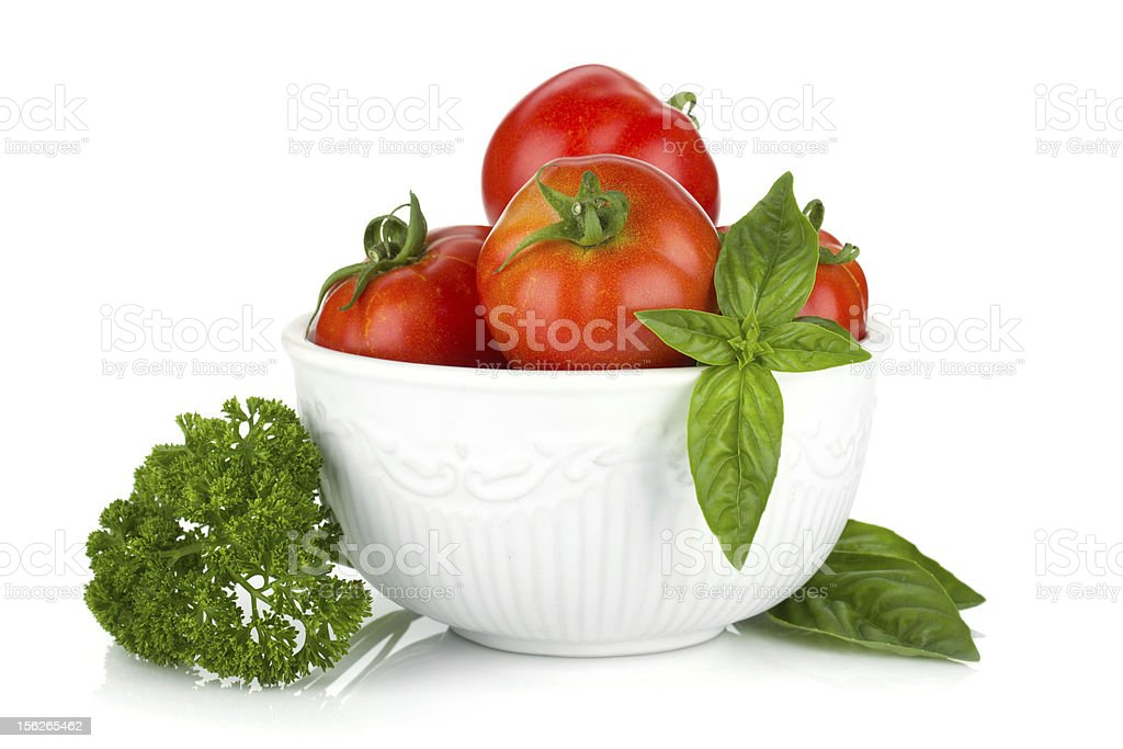 Ripe tomatoes, basil and parsley royalty-free stock photo