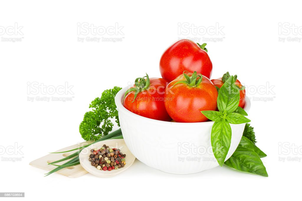 Ripe tomatoes, basil and parsley stock photo