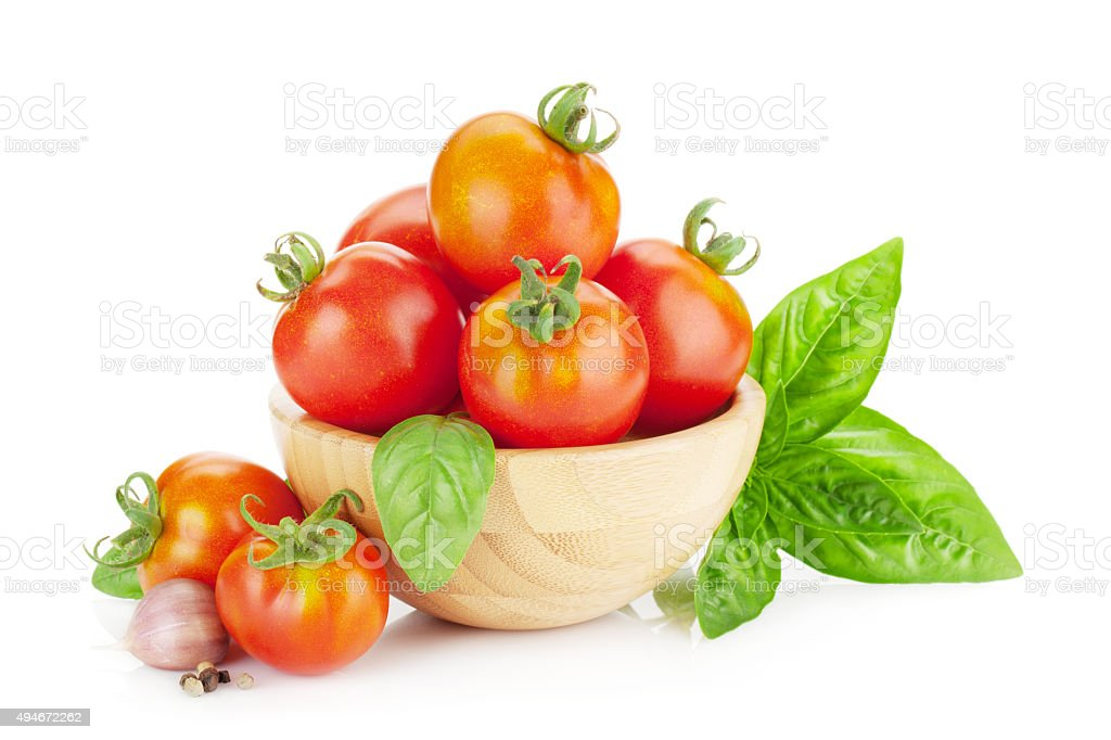 Ripe tomatoes, basil, garlic stock photo