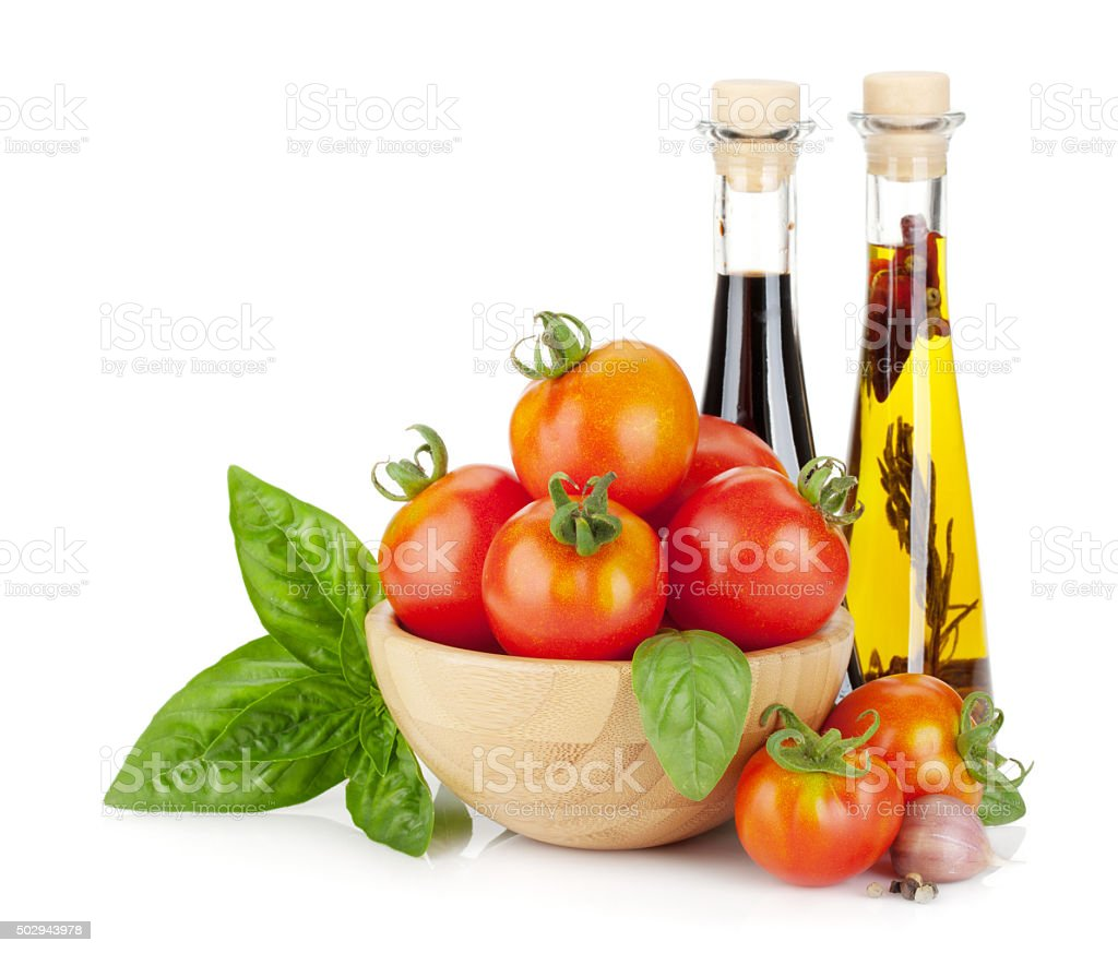 Ripe tomatoes, basil, olive oil, vinegar stock photo