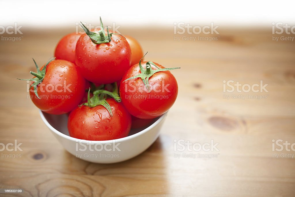 Ripe tomatoes in bowl royalty-free stock photo