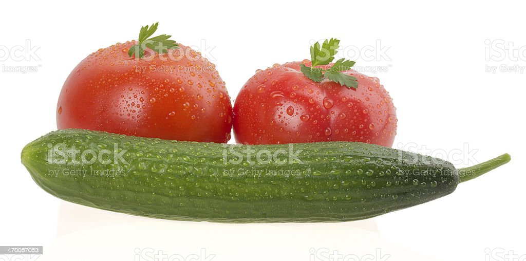 Ripe tomatoes with cucumber stock photo