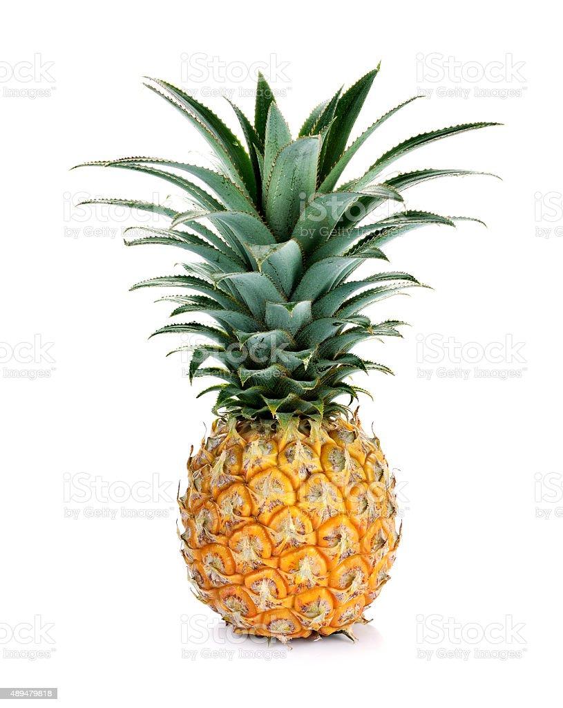 Ripe whole pineapple isolated on white stock photo