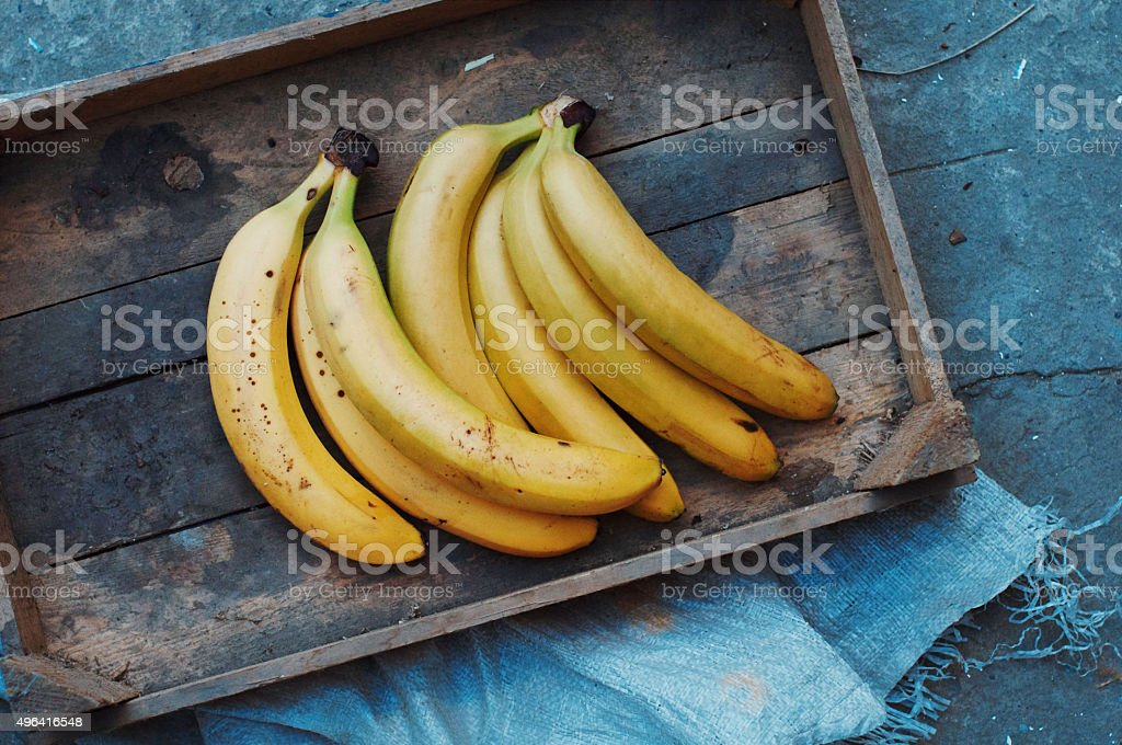 ripe yellow bananas in wicker basket royalty-free stock photo
