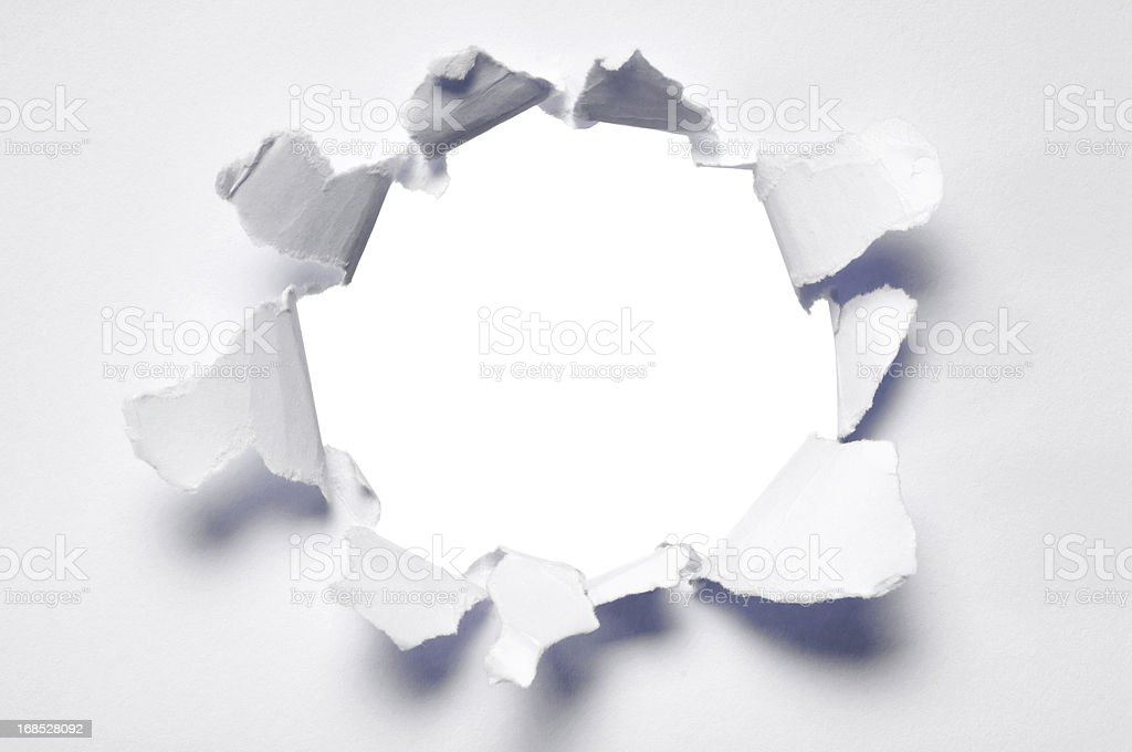 Ripped hole in blank paper stock photo