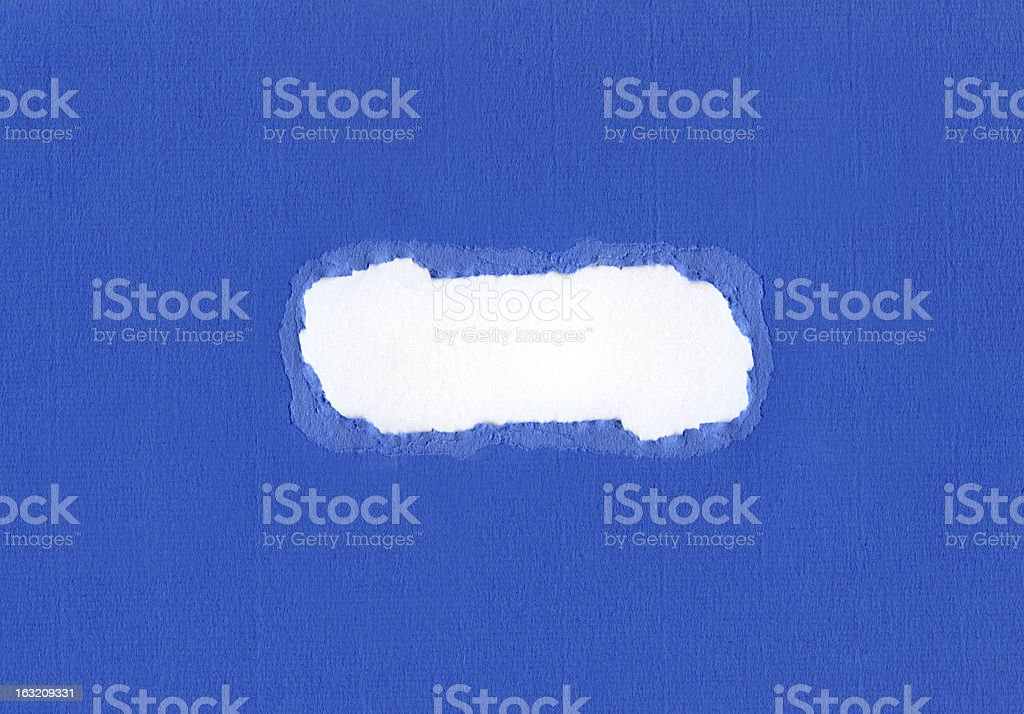 Ripped Hole in Blue Card royalty-free stock photo
