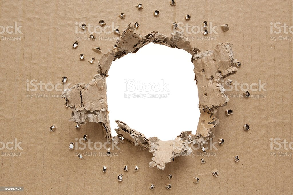Ripped hole in cardboard background royalty-free stock photo