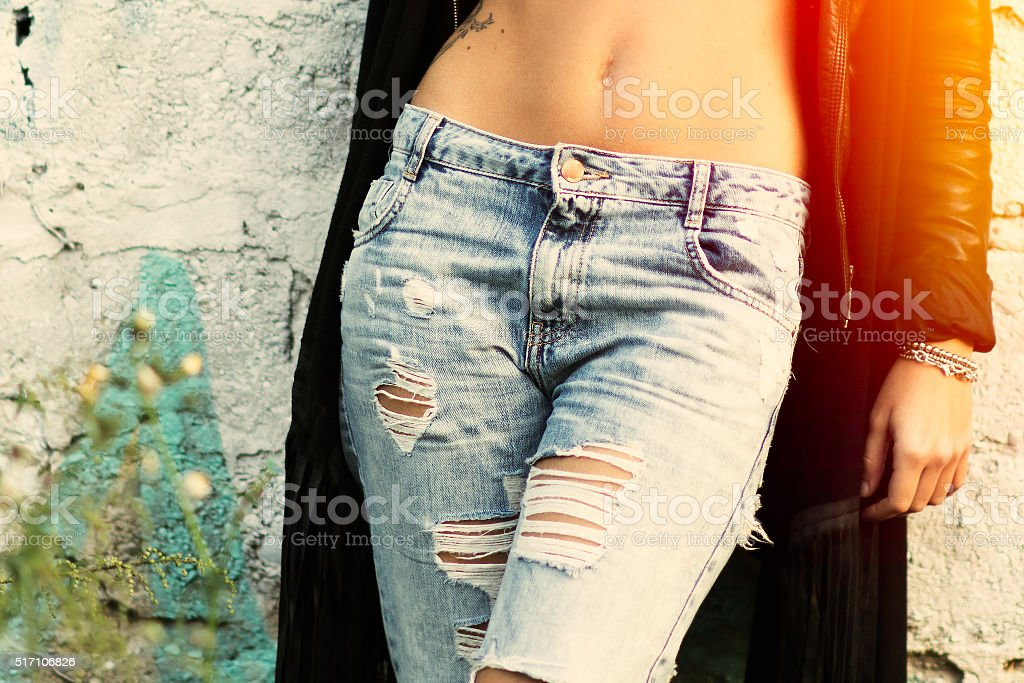 Ripped jeans girl stock photo