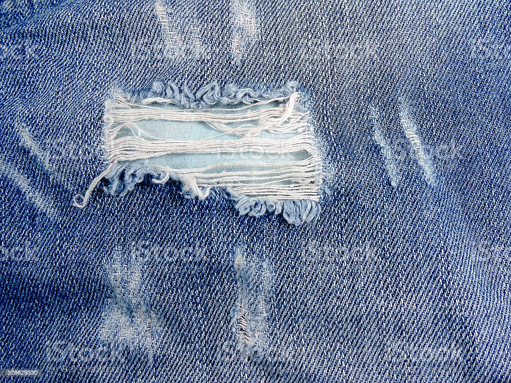 Ripped jeans. stock photo