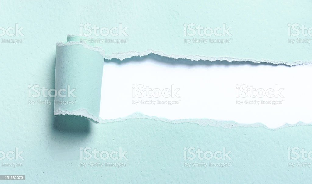 Ripped light blue paper stock photo