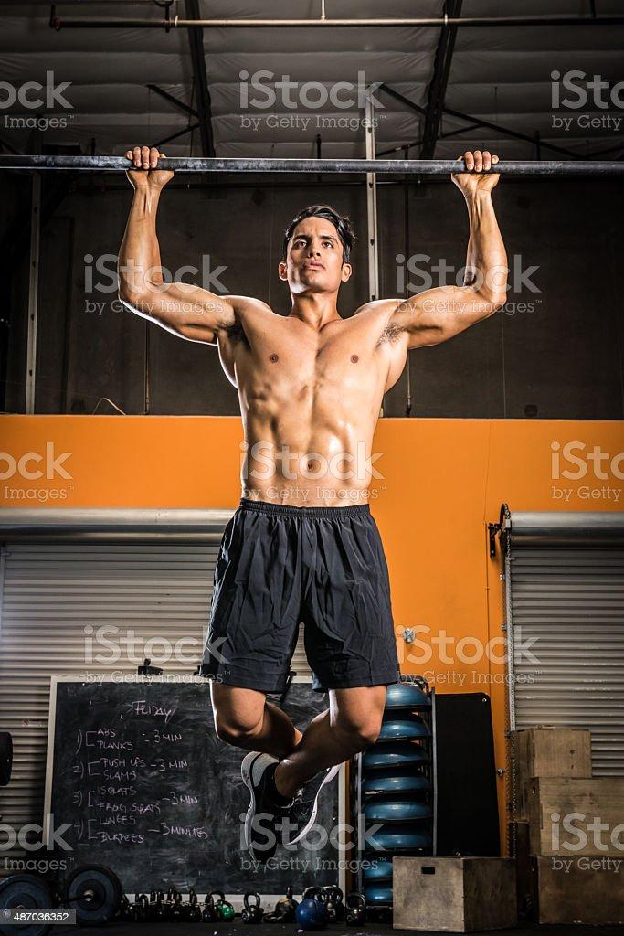 Ripped Man Doing Pull Ups stock photo