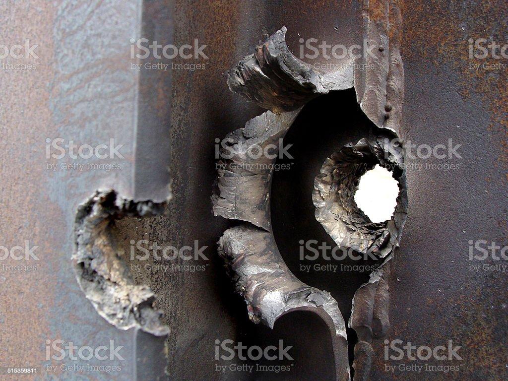 Ripped straight through - Bullethole stock photo