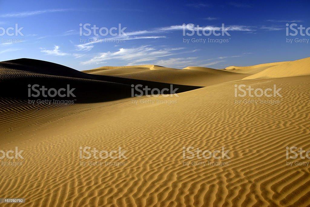 Rippled sand dunes at sunset stock photo