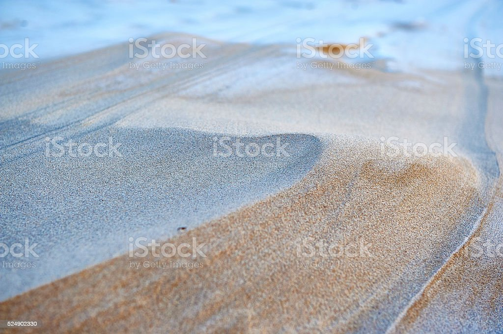 Rippled sand on beach shaped by wind stock photo