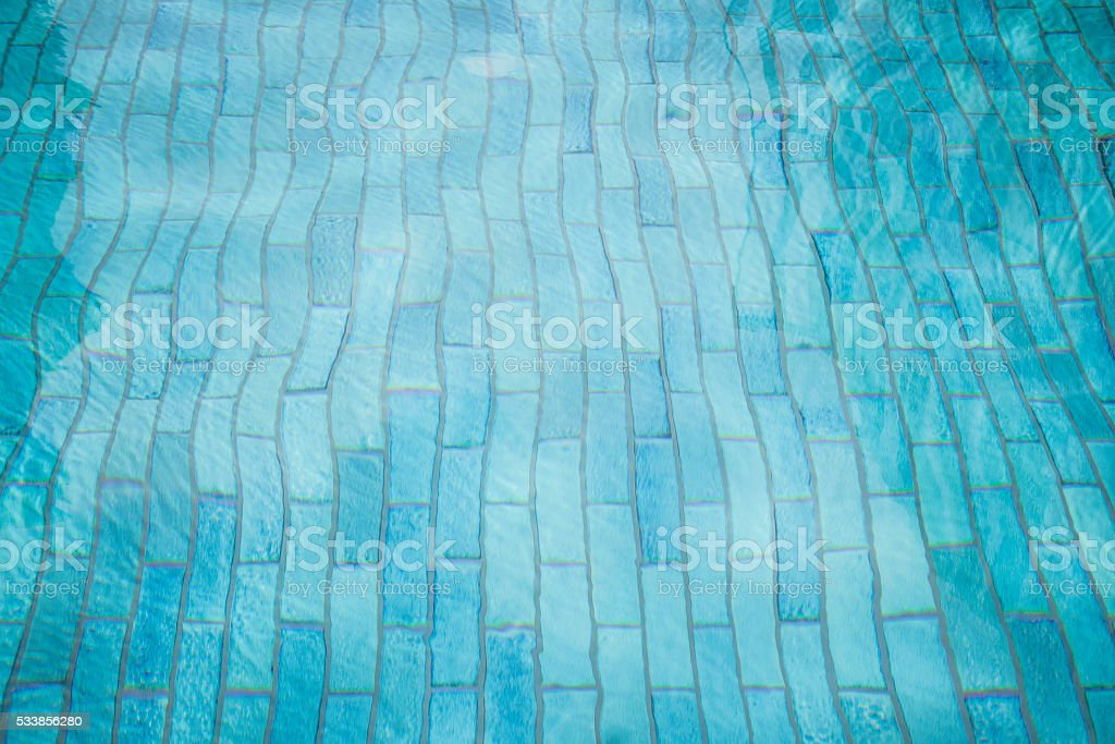 Rippled water in swimming pool background stock photo