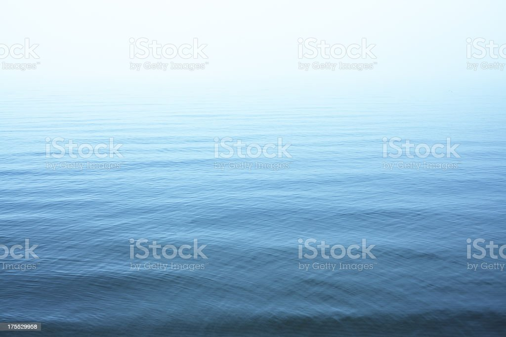 Ripples on blue water surface stock photo