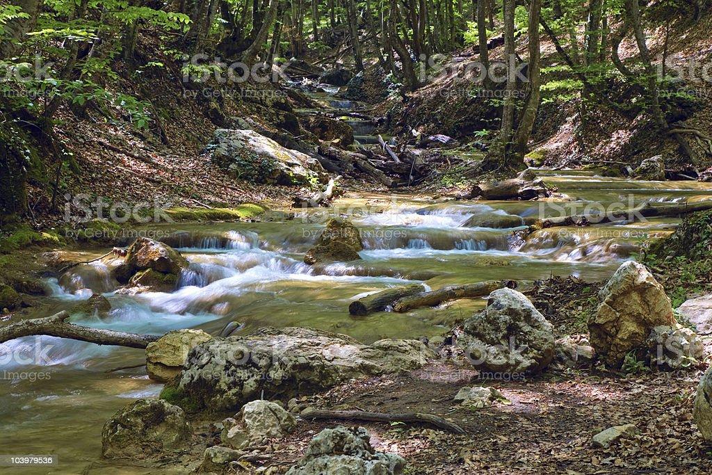 ripples on mountain river stock photo
