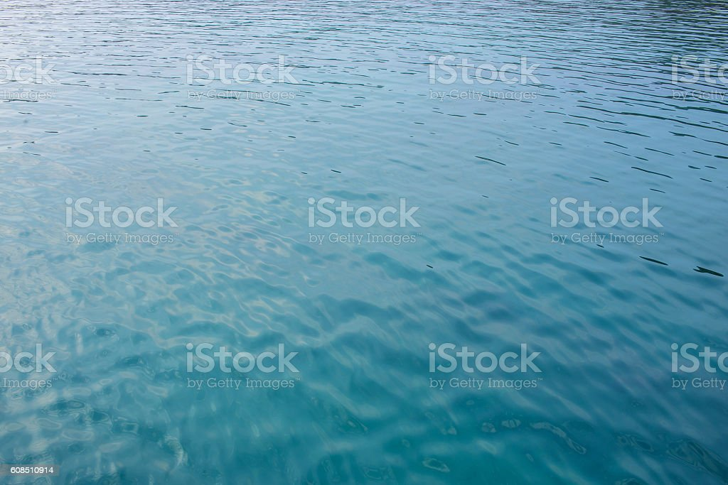 ripples on the water surface with reflection of sky stock photo