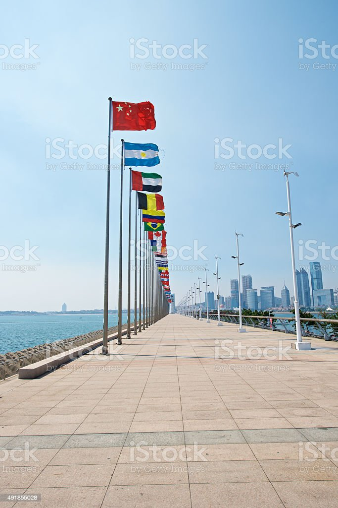 Rise of China flag as leader in qingdao stock photo