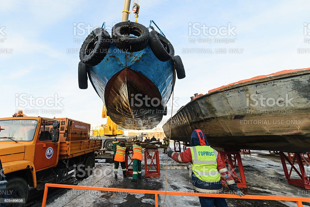 Rise of the vessel from the river on a winter stock photo