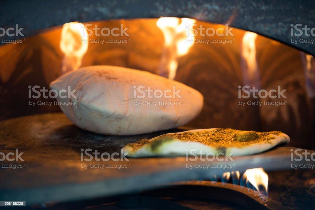 Risen pita bread in Tabun oven. stock photo