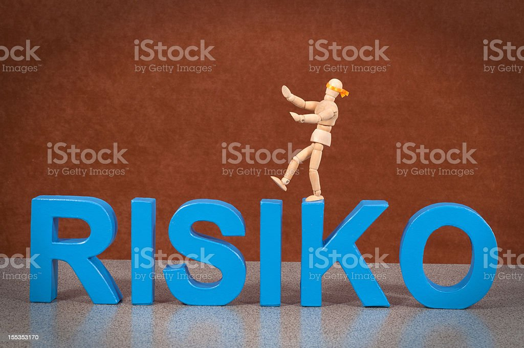 Risiko - Wooden Mannequin demonstrating this word stock photo