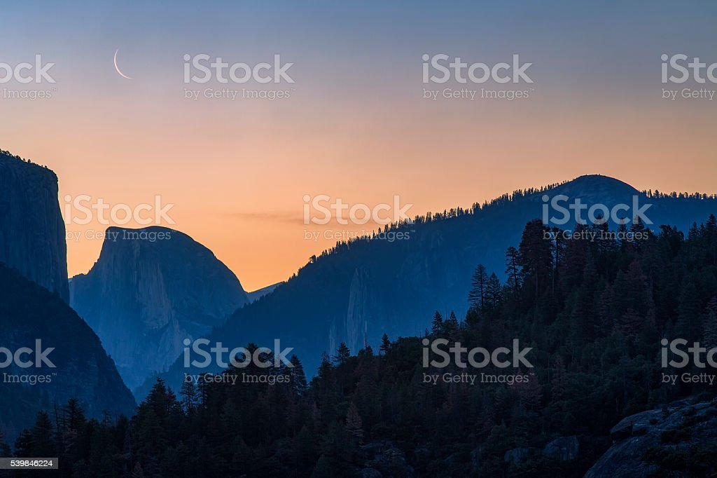 Rising Crescent Moon Over Half Dome stock photo