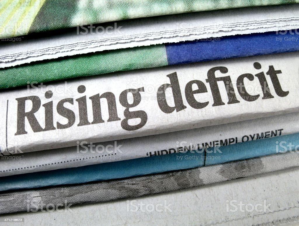 Rising Deficit Newspaper Headline stock photo