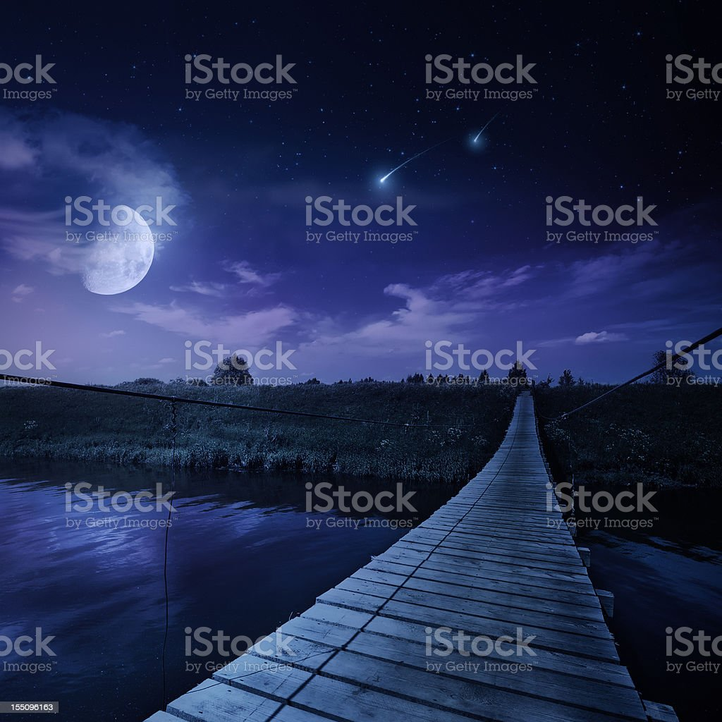 Rising moon over river stock photo