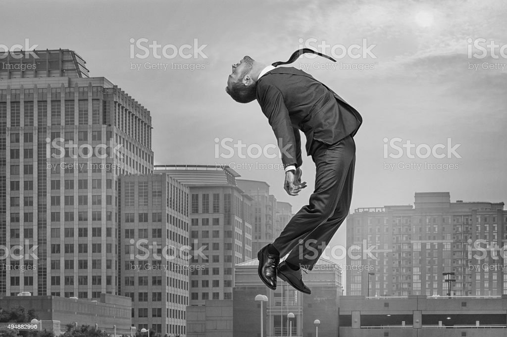 Rising or Falling Businessman stock photo