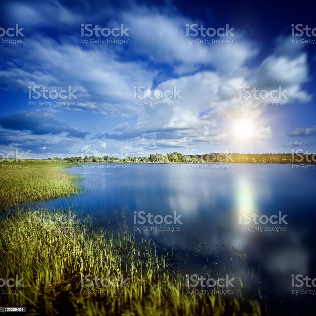 Rising sun over lake stock photo