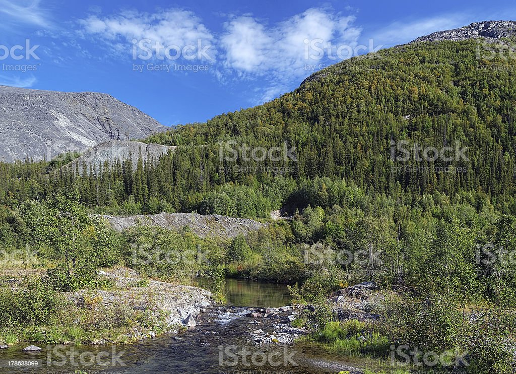 Risjok river, Rischorr massif and Kuelpor mount in Khibiny Mountains stock photo