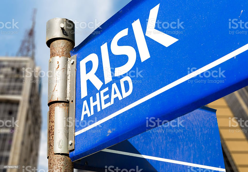 Risk Ahead blue road sign stock photo