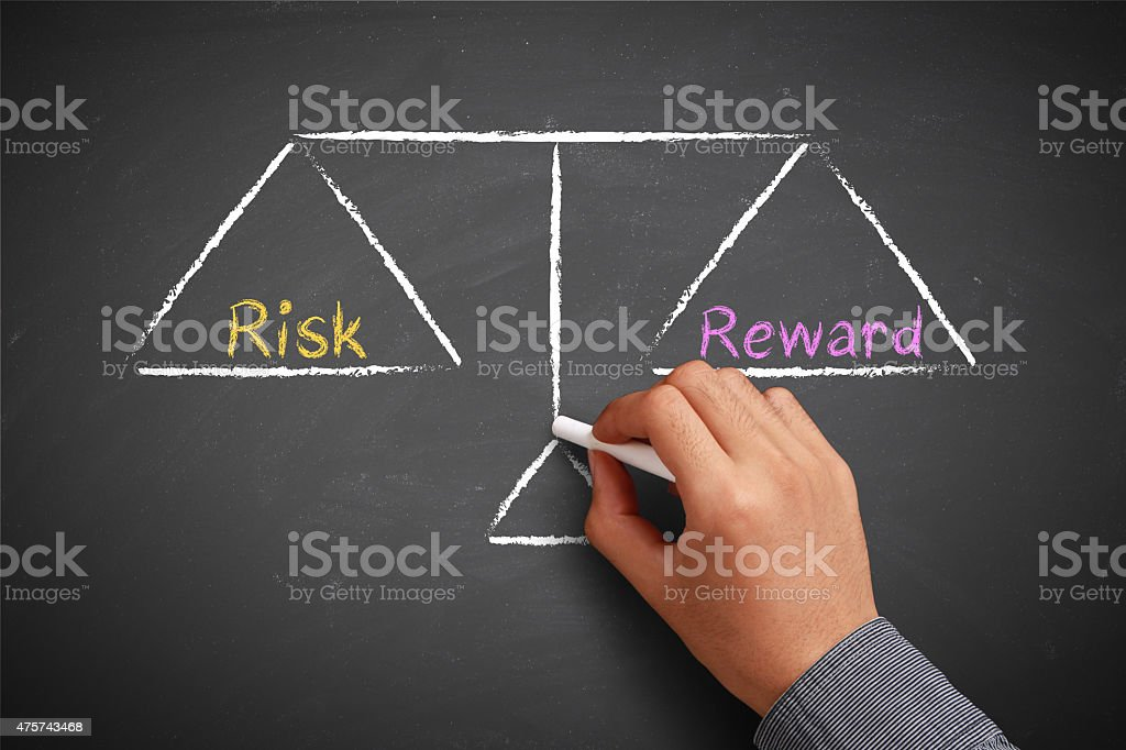Risk and reward balance stock photo