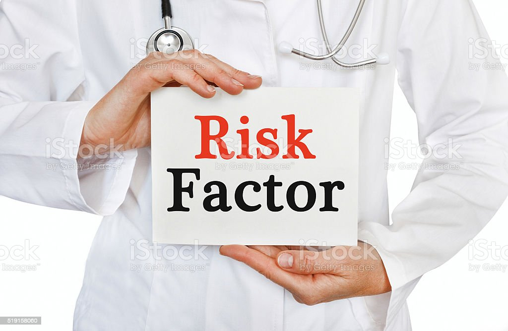 Risk Factor card in hands of Medical Doctor stock photo