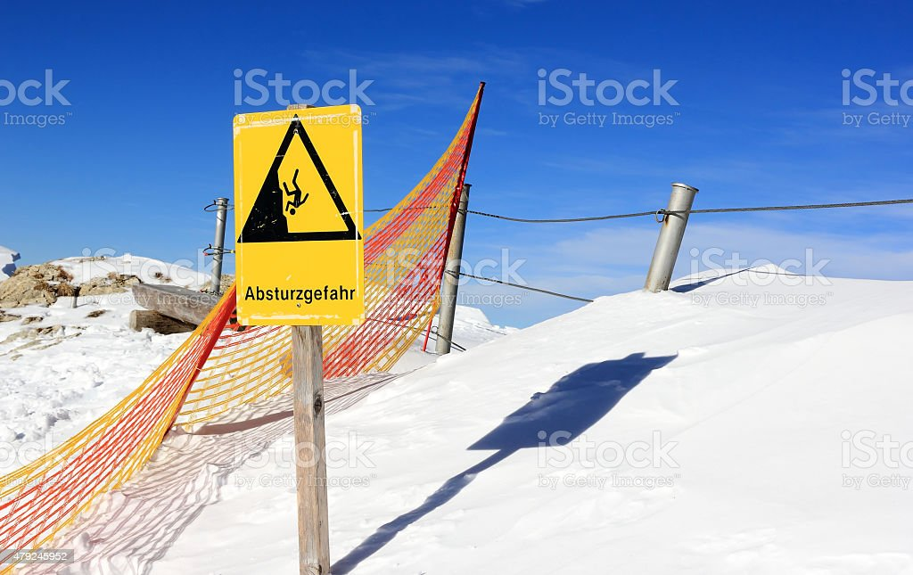 Risk of falling! The Nebelhorn Mountain in winter. Alps, Germany. stock photo