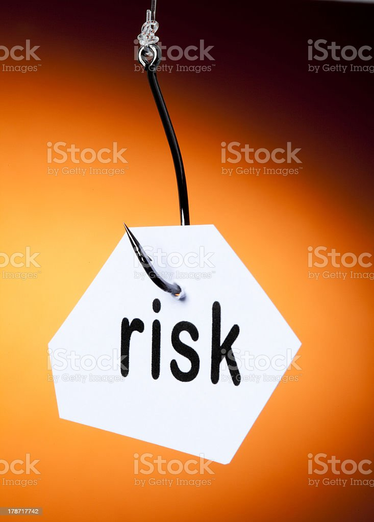 risk word on hook royalty-free stock photo